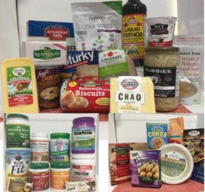 Products sold at Health Nuts including vegan cheese, protein powder, vegan taquitos, coconut yogurt, chia seeds, and soup.
