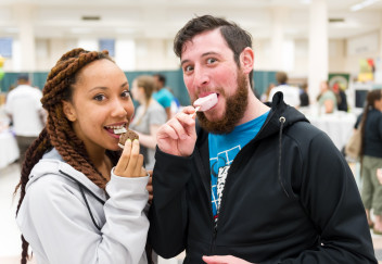 Woman and man sampling ice cream