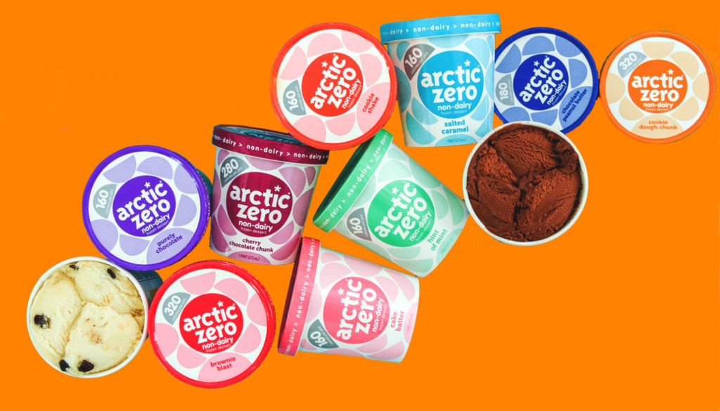 Colorful pints of Arctic Zero laid out on an orange background